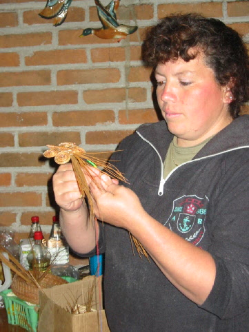 Basilia creating a Pine Needle Butterfly