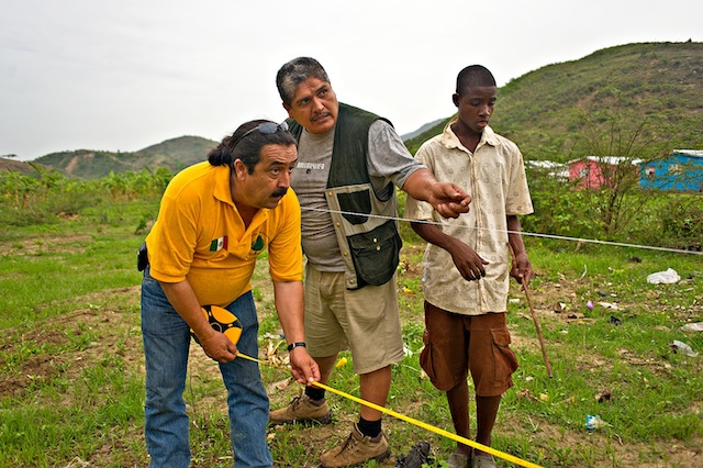Photo of José Luis, Javier and helper